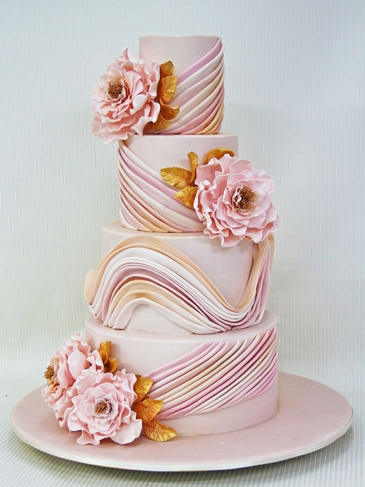 Amazing blush and gold wedding cake! I love the sugar flowers! Blush wedding ideas, black tie wedding cakes