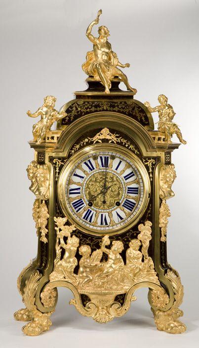 Beautiful antique gilt figural clock.                                                                                                                                                                                 More
