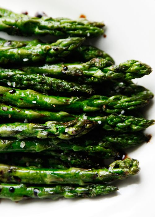 Win. The only way I cook asparagus now. I season with garlic and salt. 8 minutes give or take depending on thickness of the stalks. For thin stalks: Lay in single layer on sprayed cookie sheet. Drizzle with olive oil and season to taste. Bake at 450 for 6-7 minutes.