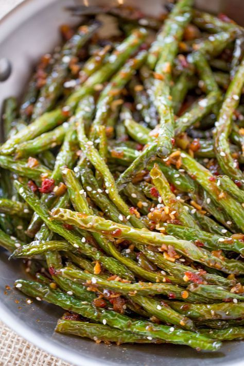 Spicy Chinese Sichuan Green Beans are the perfect easy side dish to your favorite Chinese meal and they're a breeze to make with just a few ingredients.