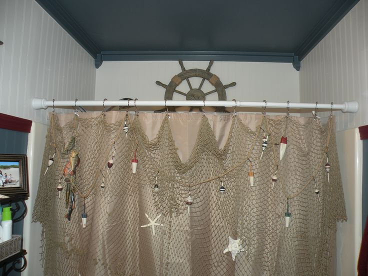 I hung a decorative fishing net with wooden fish and real starfish instead of a fancy shower curtain