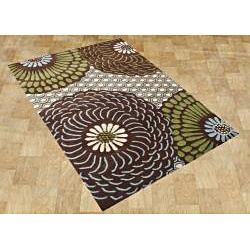 An oversized floral pattern of brown, green, blue, and beige graces this hand-tufted, hand-carved, and hand-shaved Alliyah area rug. A New Zealand blended wool construction leads to a soft, beautiful, and durable end product.http://www.overstock.com/Home-Garden/Hand-tufted-Alliyah-Brown-Wool-Rug-8-x-10/6977857/product.html?CID=214117 $345.99