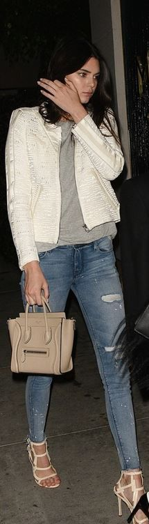 Kendall Jenner's cream jacket, blue ripped skinny jeans, sandals, and tan tote handbag.