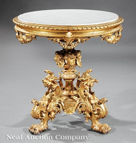 Rare American Carved and Gilded Guéridon, late 19th c., New York, inset marble top, shell and dolphin frieze, ram's head and shell mounted standard, circular plinth, griffin mounted paw feet, h. 34 3/4 in., dia. 32 1/2 in