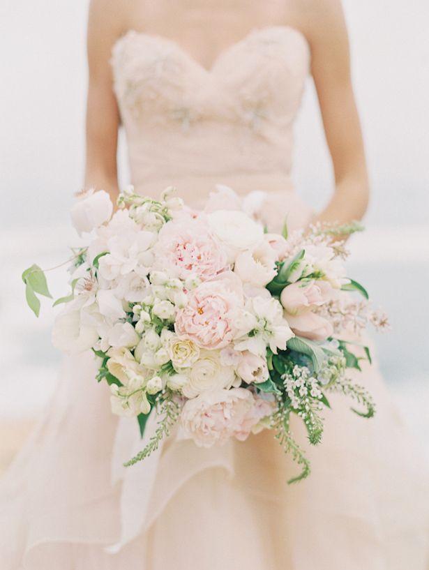 Blush and cream asymmetrical bridal bouquet | 12 Stunning Wedding Bouquets via @BelleMagazine