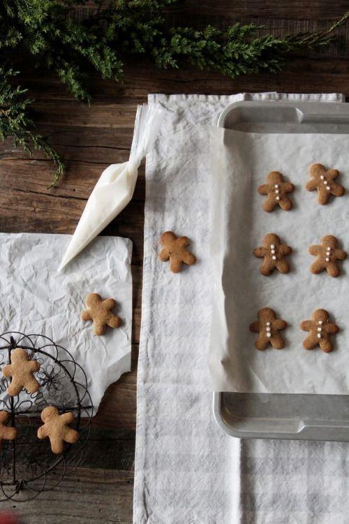 Mini gingerbread boy cookies upon a beautiful dishtowel. Subtle #holidaydecor #gingerbreadcookies #christmasbaking
