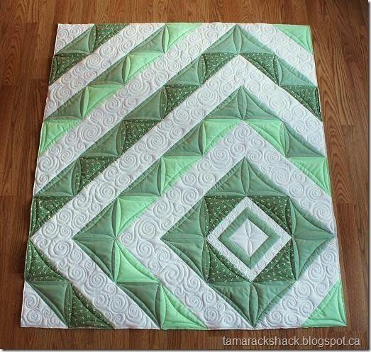 contemporary half-square triangle quilt | Found on tamarackshack.blogspot.com