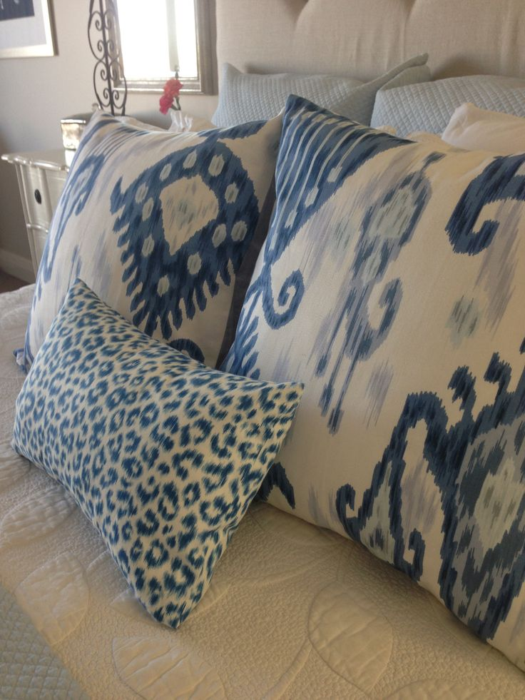 Blue and White Ikat scatter cushions with white quilt by Ornella Botter Interiors.