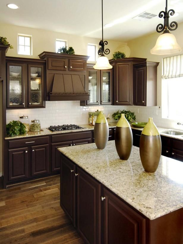 Sunny Kitchen: A Prep Island Provides Workspace In The Kitchen And Bullet  Windows Let In. Brown Cabinets KitchenDark ...