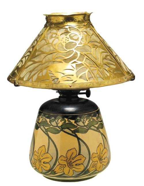 Lamp shade with magnolia design, ca. 1902. Hand-cut and embossed brass sheeting with copper rivets and screen.