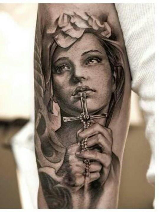 Catholic arm tattoo