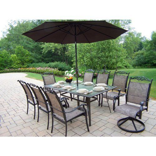 Oakland Living Cascade Patio Dining Set with Umbrella and Stand - Seats 8 Size - 8 Person by Oakland Living. $2038.00. Durable rust-free aluminum construction. Hardened powder coat finish for years of beauty. Umbrella with weighted stand to hold it in place. Glass-top dining table with seating for 8. Fade, chip, and crack resistant finish in coffee. No matter how well a dinner party may be planned, the weather is never a guarantee; fortunately, Oakland Living has accounted...