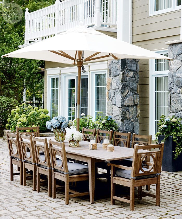 This outdoor dining area offers stunning views of the lake beyond {PHOTO: Stacey Brandford}