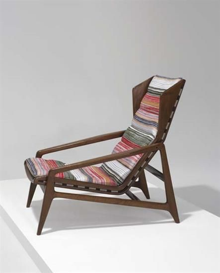 GIO PONTI Lounge chair, ca. 1955  Walnut, fabric, elasticized banding, plastic, brass. 34 in. (86.4 cm) high Manufactured by Cassina, Italy.