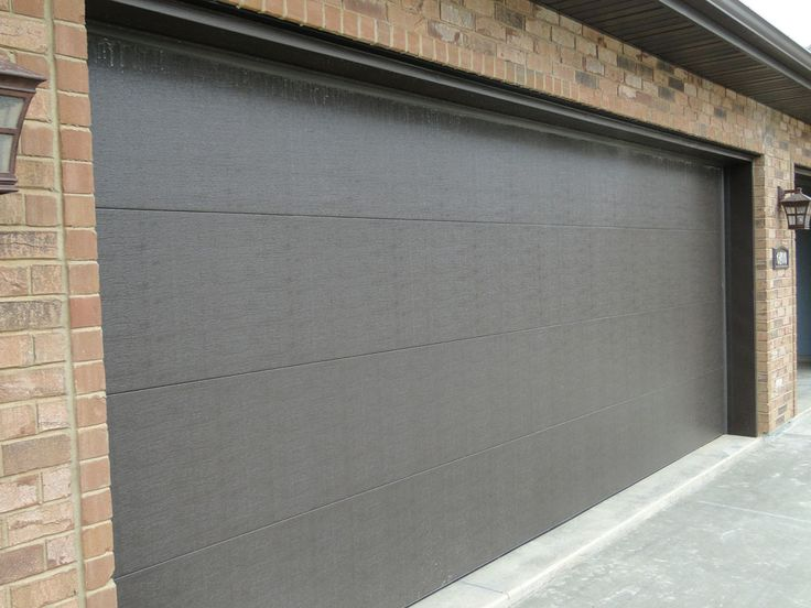 CONTEMPORARY FLAT PANEL garagedoors  Custom Homes by Tompkins