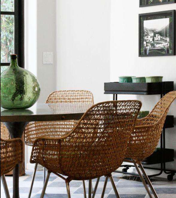 breakfast room - Nate Berkus design - wood tulip table, cane chairs, marble floors