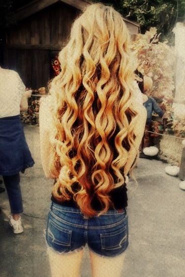 long curly hair.  this is how long I want my hair to be.  I am starting to think I'm not going to make it