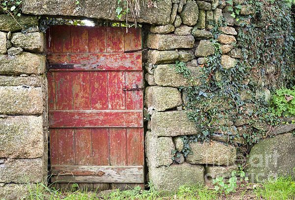 Old Red Gate At Tregathenan. Cornwall UK. We were staying at a Bed and Breakfast in Cornwall and next to the B&B's parking area was this stone wall with a red gate leading through it. I'm not sure how much the gate was in use as it was the entrance to the B&B property. Fine Art Photography  http://rob-huntley.artistwebsites.com © Rob Huntley