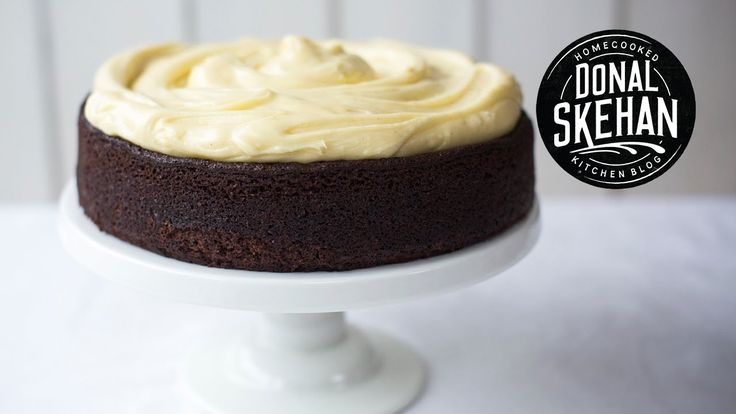 How to make Chocolate Guinness Cake... A rich, most and decadent cake covered in a white chocolate, cream cheese frosting. | DonalSkehan.com