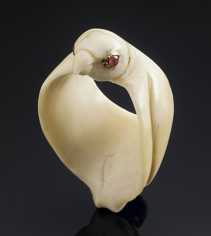 An unusual ivory Archer's Ring in the form of a Falcon  probably Mughal, 18th Century  formed by a three dimensional bird with ruby-set eyes and folded wings   4.5 cm. long