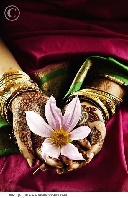 Tattooed hands holding flower