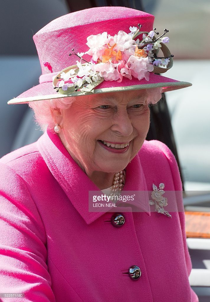Britain's Queen Elizabeth II arrives to visit the Royal Mail Windsor postal delivery office in Windsor, west of London, on April 20, 2016, to mark the 500th anniversary of the Postal Service. Hat designer:  Rachel Trevor Morgan.  This hat is new