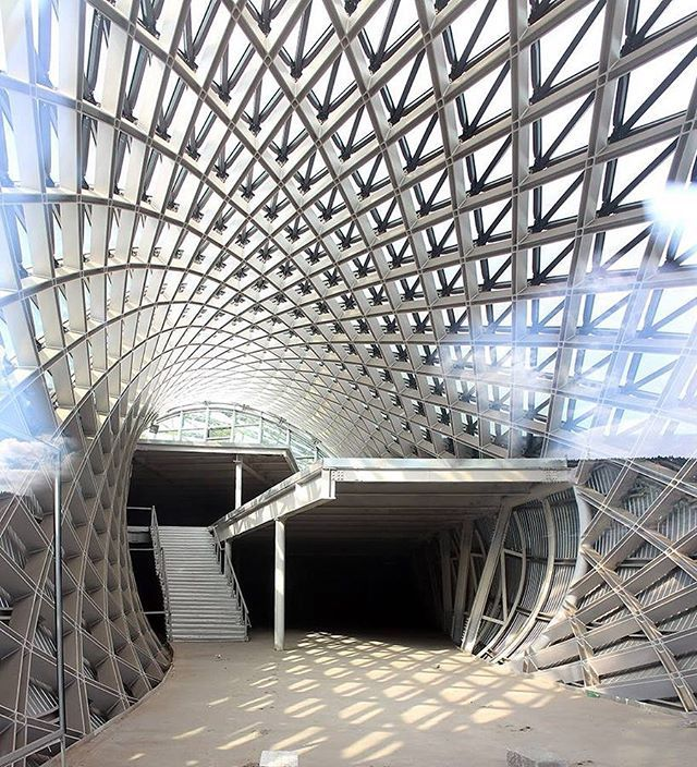fuksas reveals images of its music theater and exhibition hall in tbilisi's rhike park. #tbilisi, #georgia italian architecture studio fuksas has revealed images of a new cultural complex it is working on in the georgian capital of tbilisi. located within the city's rhike park, the building is composed of two sculptural tubular elements that both open up onto the adjacent green space. connected via a shared retaining wall, the two volumes house a musical theater and an exhibition hall…