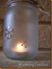 Frosting spray paint + mason jars + snowflake stickers. I love frosted glass.