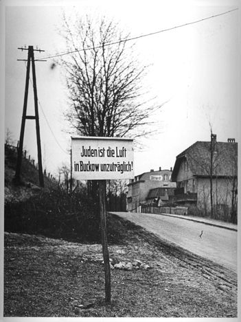 "Buckow, Germany, an antisemitic sign at the entrance to the city, ""It is forbidden for Jews to breath the air""."