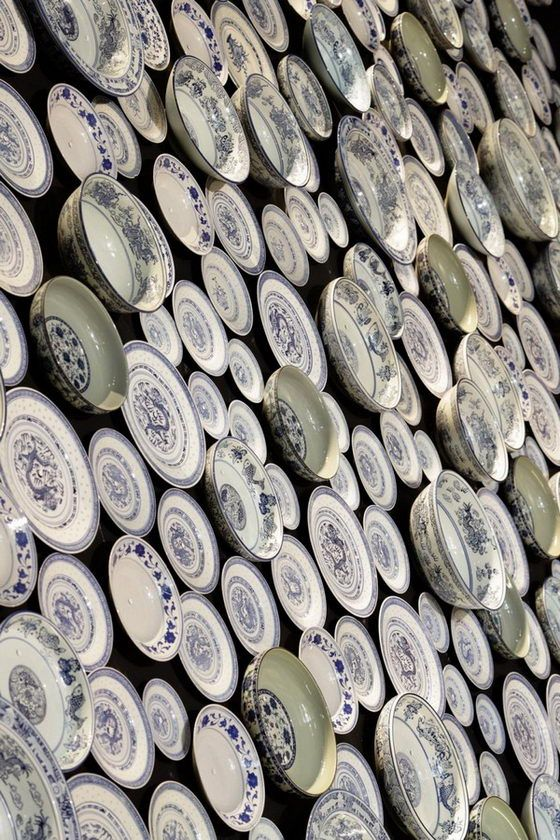 love blue and white plates, and a whole wall of them, awesome!
