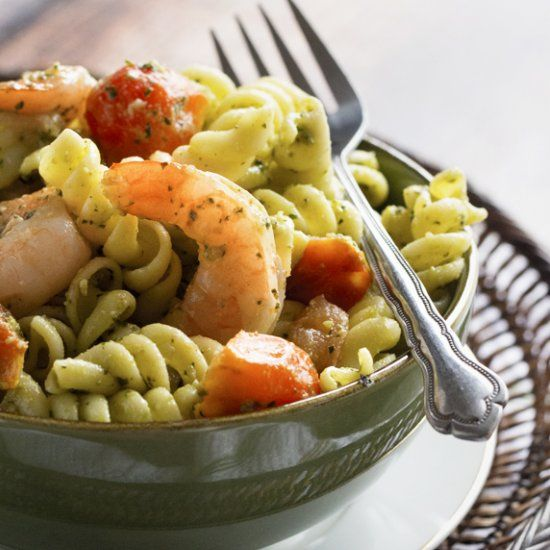 An easy shrimp and tomato pasta tossed with a homemade spinach and basil pesto.