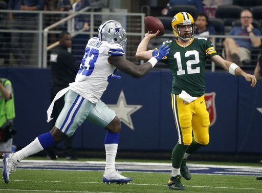 Dallas Cowboys defensive end Benson Mayowa (93) pressures as Green Bay Packers quarterback Aaron Rodgers (12) prepares to throw a pass in the first half of an NFL football game, Sunday, Oct. 8, 2017, in Arlington, Texas. (AP Photo/Michael Ainsworth)