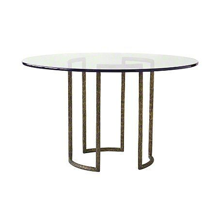 A beautiful, classically inspired design statement, the hand-cast brass dining table base is an expression of refined simplicity. The naturalistic texture of the brass frame is visible through the glass top. For larger spaces, two bases together support a racetrack oval glass top.