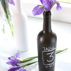 With this easy tutorial, empty wine bottles can be turned into creative vases, table numbers or candle holders.