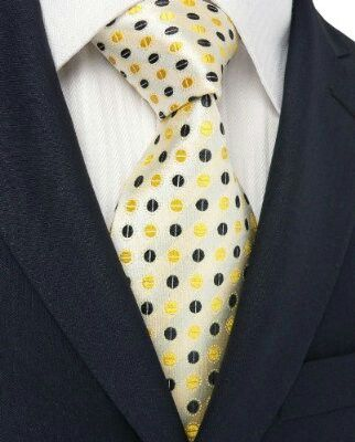 Men's suit & tie. .cream tie with black and yellow polka dots