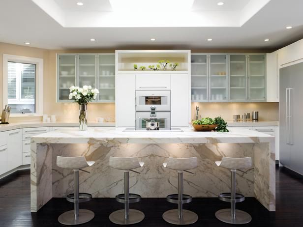 Amazing!  Marble island, frosted cabinet doors, ceiling, lighting!