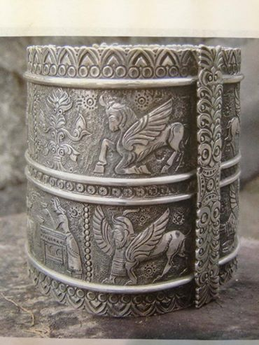 """The very name of Urartu is just another form of writing of common ARATTA -KI """"Aratta Country"""" as UR-ARATTA """"Country Aratta"""", and designated as such in early Sumerian epics since """"arat"""" is an Armenian word which means """"abundance"""" and fertile Armana which possessed the sources of the Tigris and Euphrates was the Country of Abundance and was named as such.  Arman Revazyan, Sumerologist  Bracelet depicting Van Kingdom (Ararat-Urartu) by Mamikon Mkhitaryan."""