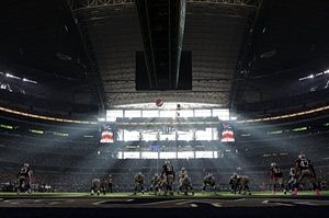 The Dallas Cowboys quarterback Brandon Weeden prepares to snap the football during the second half of the NFL game against the New England Patriots at the AT&T Stadium, Arlington, Texas. The Patriots defeated the Cowboys 30-6.