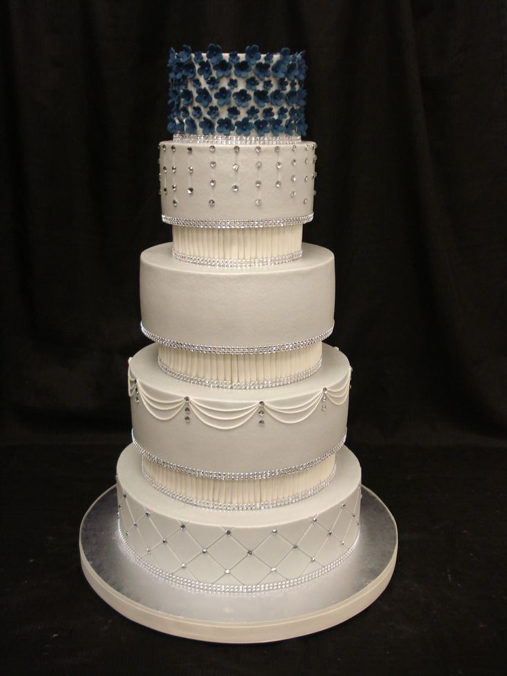 Light blue wedding cake with buttercream base, bling and ...