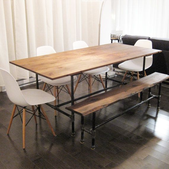 The Ziggy - dining table made from recycled barn wood and cast iron pipe leg armature via Etsy
