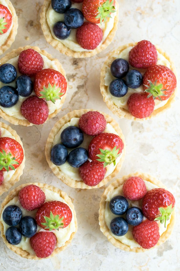 When Spring starts to turn into Summer, and British berries come into season, there is one elegant little sweet treat I can't wait to make. Fruit tarts. Tender pastry cases filled with creme patissiere and topped with bright and bouncy seasonal fruit - simple components which add up to a delectable warm weather treat. The