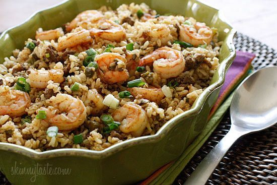 "A healthier twist on a Cajun classic, the addition of shrimp turns this into a fabulous main dish. I'd like to think of this as a Cajun shrimp fried rice. With Mardi Gras ends tomorrow, I thought this would be the perfect timing to share this recipe from the archives because I LOVE this dish!  Dirty rice is a classic Cajun dish made ""dirty"" by cooking the rice with minced livers or gizzards. I created a healthier version using brown rice and lean ground beef in place of the chicken livers…"