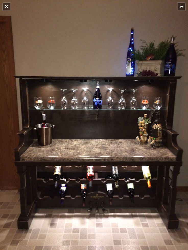 Repurposed piano into wine bar. Well worth the time :) made by my amazing parents!