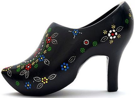 he high-heeled Staphorster clog is hand painted in an old traditional dotted craftwork pattern by an old lady from Staphorst. The wooden clog was manufactured by Jos Hogenkamp.