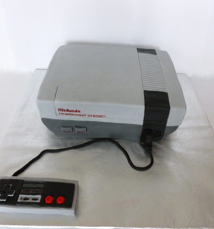 HOLY CRAP BALLS    Nintendo Cake - This is cake was made to resemble a Nintendo.  It takes me back :) Nothing but fond memories or Mario and Duck Hunt!