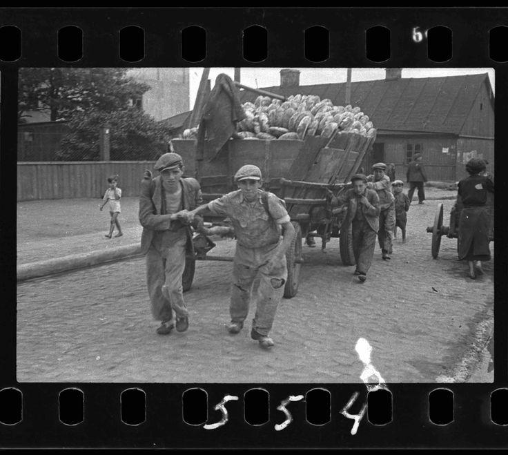 10. Men hauling a cart for bread distribution_Henryk Ross copy