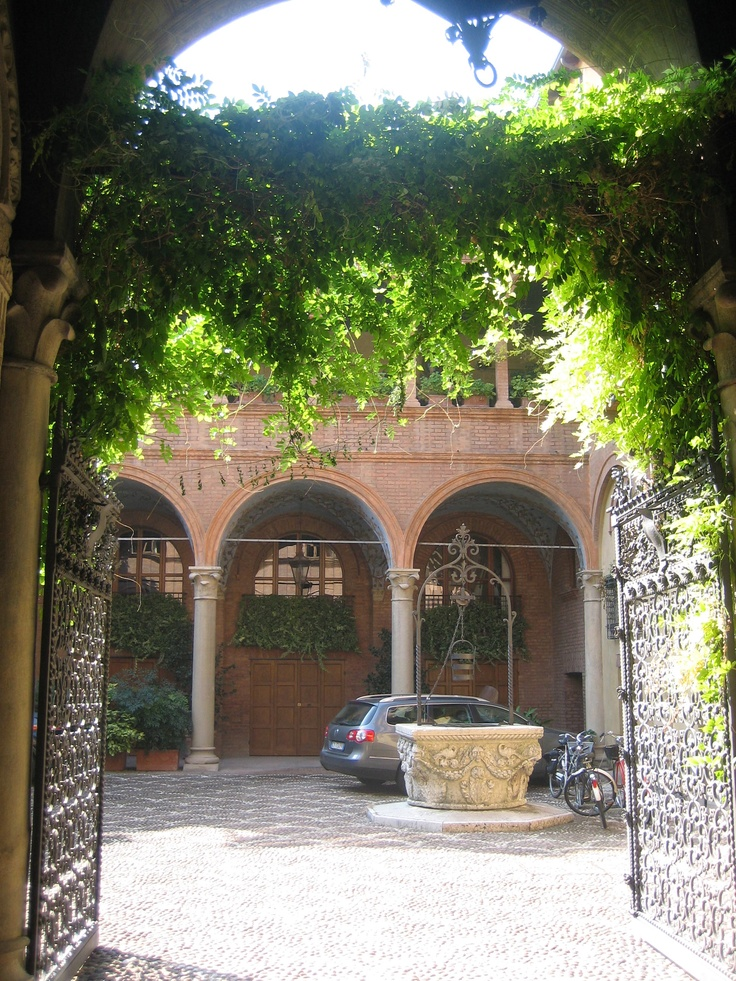 I have a picture in this VERY spot in Reggio Emilia, Italy, except when I was there the wisteria was blooming...