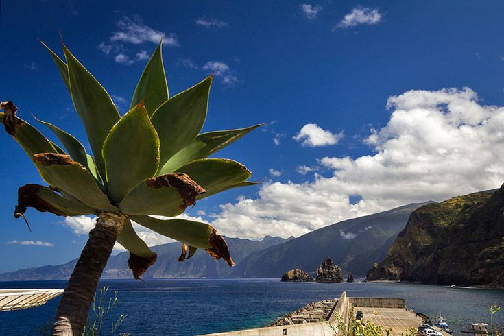 Where to go on holiday in August | http://www.weather2travel.com/holidays/where-to-go-on-holiday-in-august-for-the-best-hot-and-sunny-weather.php | Blue skies over Madeira in September © Thomas Jaworski - Flickr Creative Commons
