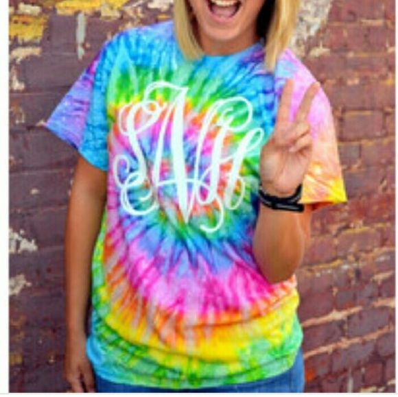 Custom Monogram Tye Dye T Shirt Super cute custom tye dye tee! Perfect for the spring! Personalize with your monogram in the font of your choice! Choose from the 4 tye dye colors in picture 2  Unisex sizing   Available in small medium and large, ask me if your size and color choice is in stock! Twang Boutique  Tops Tees - Short Sleeve