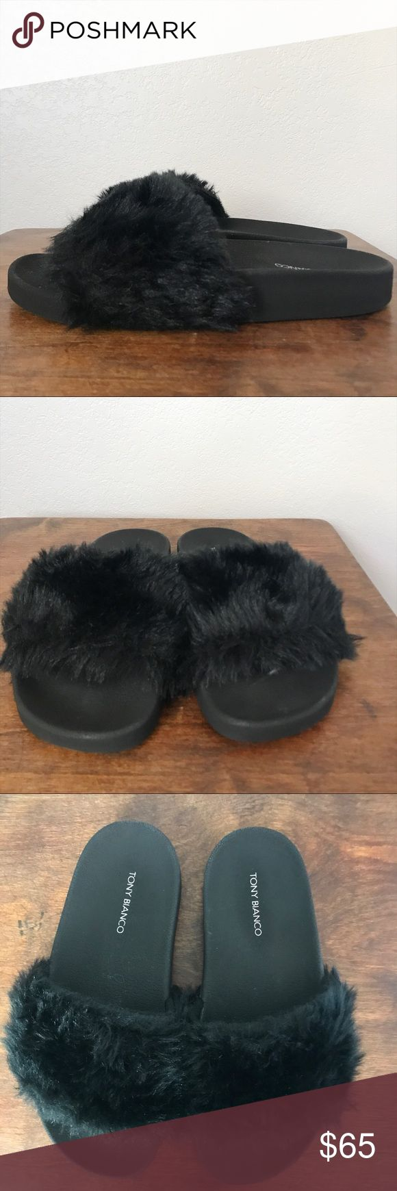 Tony Bianco Vixen Slide Black Sandal in Size 7 Tony Bianco Vixen Slide Black Sandal in Size 7 A fuzzy slide is edgy and takes street style to the next level. The sandal has a faux-fur finish and a comfortable molded sole for wear-everywhere. NWOT  Please check out the other items that I have for sale! Tony Bianco Shoes Sandals